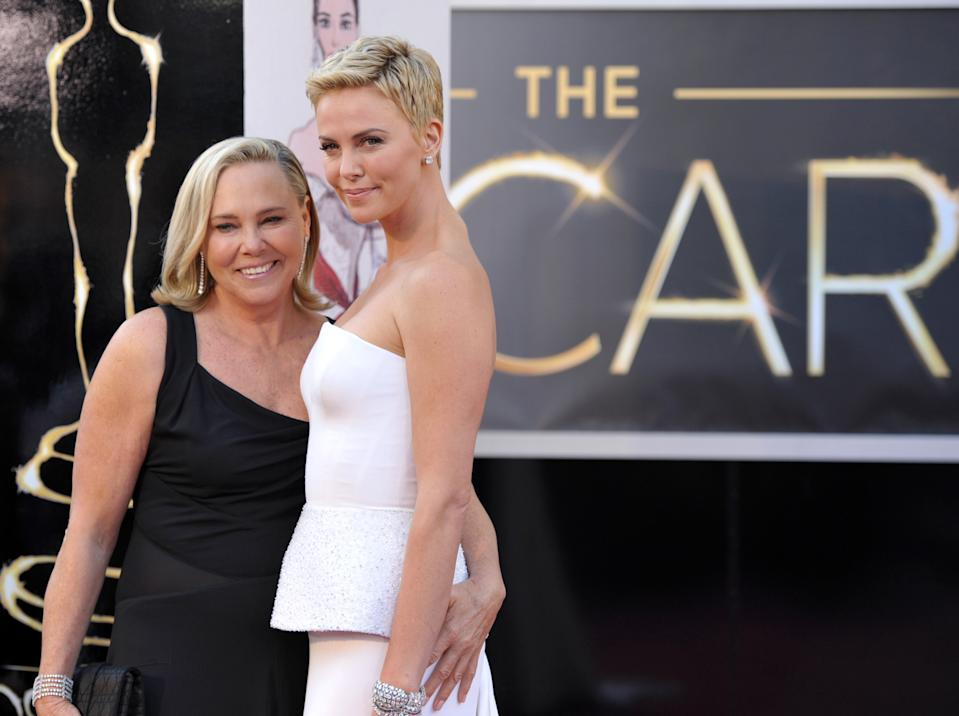 Actress Charlize Theron, right, and Gerda Jacoba Aletta Maritz arrive at the Oscars at the Dolby Theatre on Sunday Feb. 24, 2013, in Los Angeles. (Photo by John Shearer/Invision/AP)