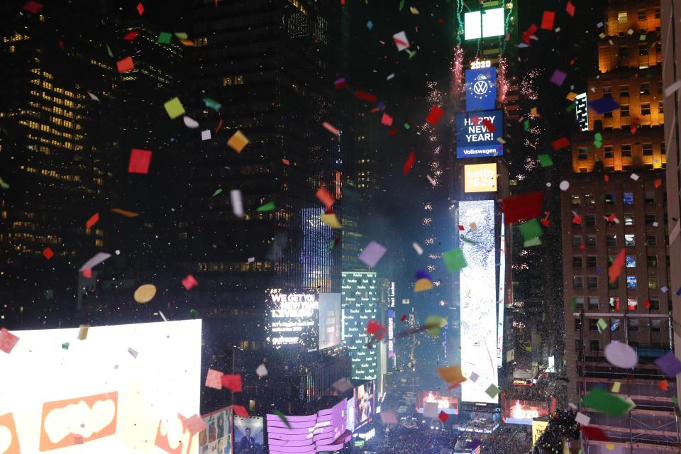 Confetti drops over the crowd as the clock strikes midnight during the New Year's celebration as seen from the New York Marriott Marquis in New York's Times Square, Wednesday, Jan. 1, 2020. (AP Photo/Frank Franklin II)