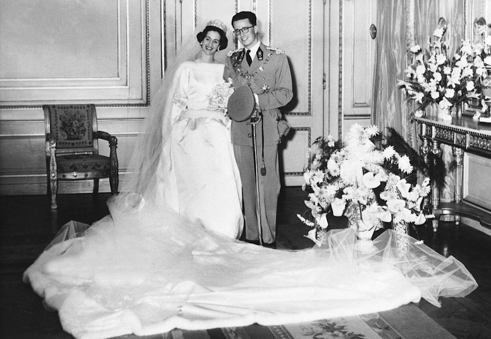 "<p><span class=""redactor-unlink"">Dona Fabiola of Spain</span> married King Baudouin of Belgium on December 15, 1960 in the <span class=""redactor-unlink"">Cathedral of St. Michael and St. Gudula</span>. Designed by Cristóbal Balenciaga, her wedding dress featured a high neckline trimmed in ermine fur, and three-quarter length sleeves with a drop waist and a full skirt.</p>"