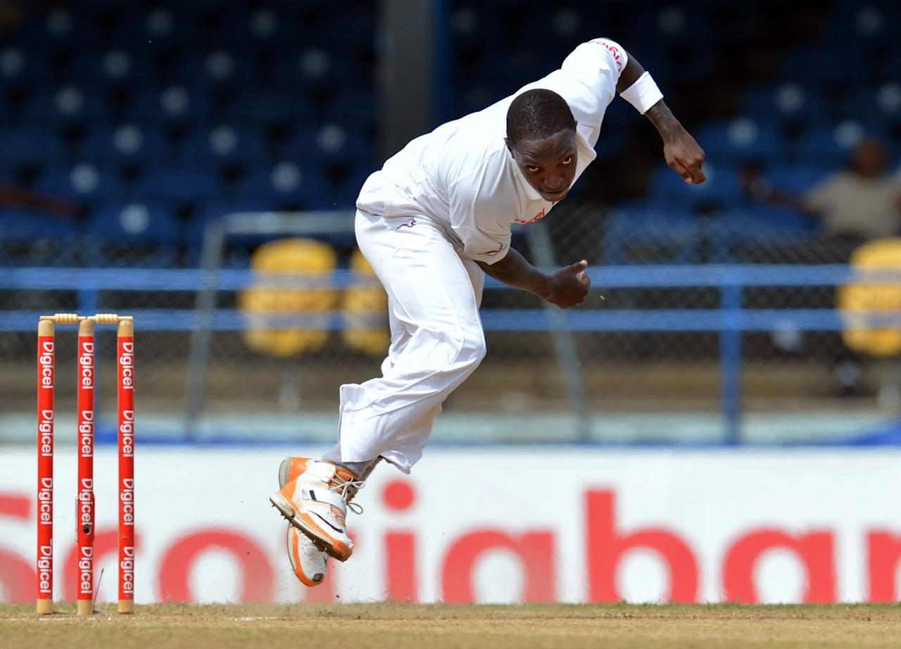 West Indies bowler Fidel Edwards delivers during the fourth day of the second-of-three Test matches between Australia and West Indies April 18, 2012 at Queen's Park Oval in Port of Spain, Trinidad.
