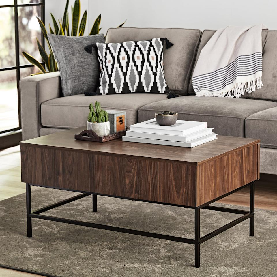 """<p>We love the wood finish of this <a href=""""https://www.popsugar.com/buy/Mainstays-Sumpter-Park-Coffee-Table-424201?p_name=Mainstays%20Sumpter%20Park%20Coffee%20Table&retailer=walmart.com&pid=424201&price=60&evar1=casa%3Aus&evar9=45867877&evar98=https%3A%2F%2Fwww.popsugar.com%2Fhome%2Fphoto-gallery%2F45867877%2Fimage%2F46654231%2FMainstays-Sumpter-Park-Coffee-Table&list1=shopping%2Chome%20decor%2Cfurniture%2Chome%20shopping&prop13=api&pdata=1"""" rel=""""nofollow"""" data-shoppable-link=""""1"""" target=""""_blank"""" class=""""ga-track"""" data-ga-category=""""Related"""" data-ga-label=""""https://www.walmart.com/ip/Mainstays-Sumpter-Park-Coffee-Table-Multiple-Finishes/273410947?selected=true"""" data-ga-action=""""In-Line Links"""">Mainstays Sumpter Park Coffee Table</a> ($60).</p>"""