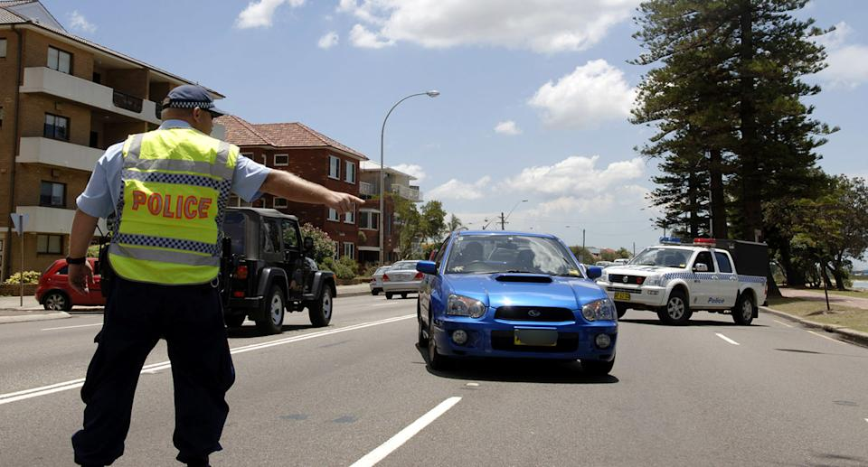 NSW Police officer pulls over a car. Source: AAP