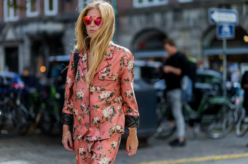 COPENHAGEN, DENMARK - AUGUST 10: A guest wearing a pink pyjama suit with floral print outside Fonnesbech during the first day of the Copenhagen Fashion Week Spring/Summer 2017 on August 10, 2016 in Copenhagen, Denmark. (Photo by Christian Vierig/Getty Images)