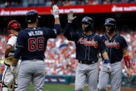 From right to left, Atlanta Braves' Tyler Flowers, Dansby Swanson, Tyler Flowers and Bryse Wilson celebrate past Philadelphia Phillies catcher J.T. Realmuto after Swanson's two-run home off starting pitcher Nick Pivetta during the second inning of a baseball game, Saturday, March 30, 2019, in Philadelphia. (AP Photo/Matt Slocum)