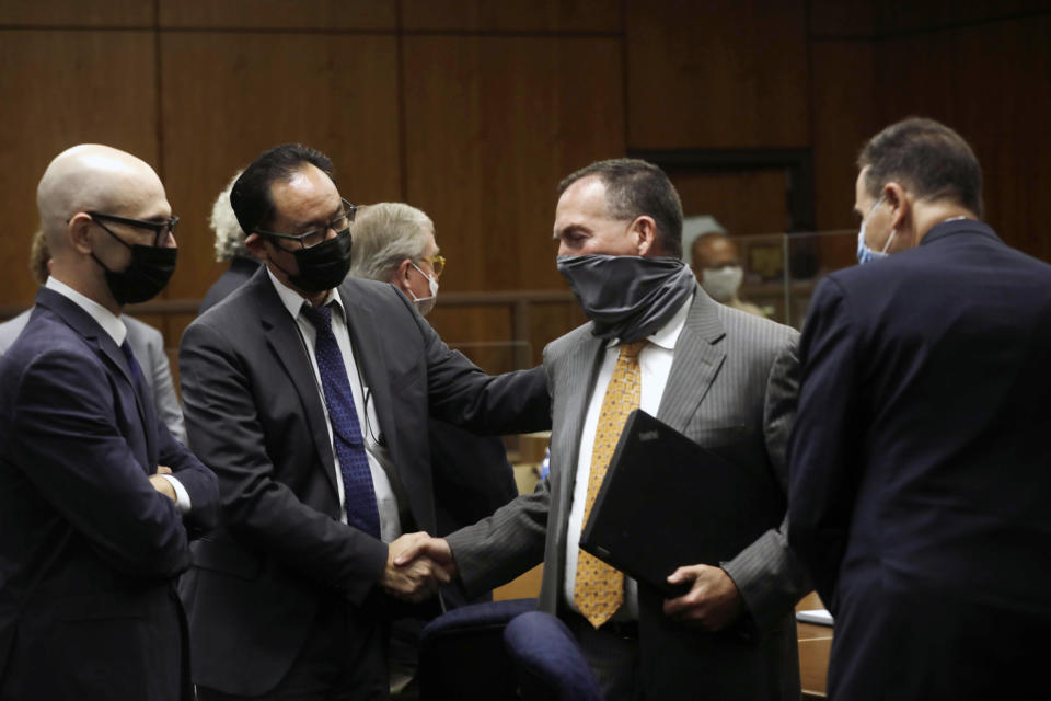 Deputy District Attorney John Lewin, center, is congratulated as attorney Habib A. Balian, right, looks on after New York real estate heir Robert Durst was found guilty Friday, Sept. 17, 2021 in Inglewood, Calif. A Los Angeles jury convicted Robert Durst on Friday of murdering his best friend 20 years ago, a case that took on new life after the New York real estate heir participated in a documentary that connected him to the slaying that was linked to his wife's 1982 disappearance. (Genaro Molina/Los Angeles Times via AP, Pool)