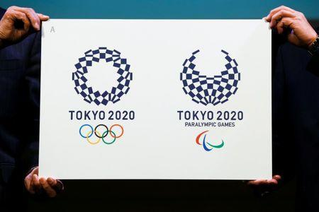 FILE PHOTO: Tokyo 2020 Emblems Selection Committee Chairperson Ryohei Miyata (R) and committee member Sadaharu Oh present the winning design of the Tokyo 2020 Olympic Games and Paralympic Games during its unveiling ceremony in Tokyo, Japan April 25, 2016. REUTERS/Thomas Peter Picture Supplied by Action Images