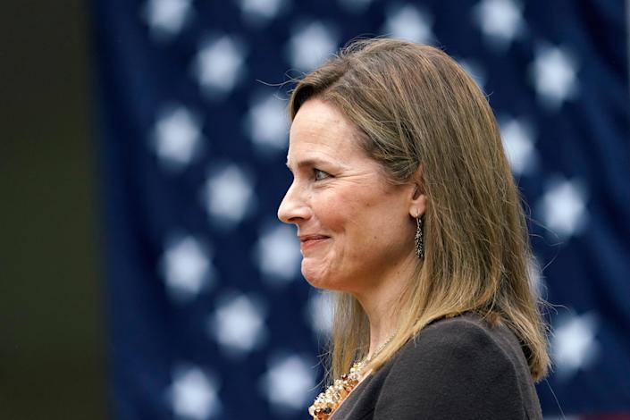 Judge Amy Coney Barrett listens as President Donald Trump announces her as his nominee to the Supreme Court in the Rose Garden at the White House, Saturday, Sept. 26, 2020, in Washington.