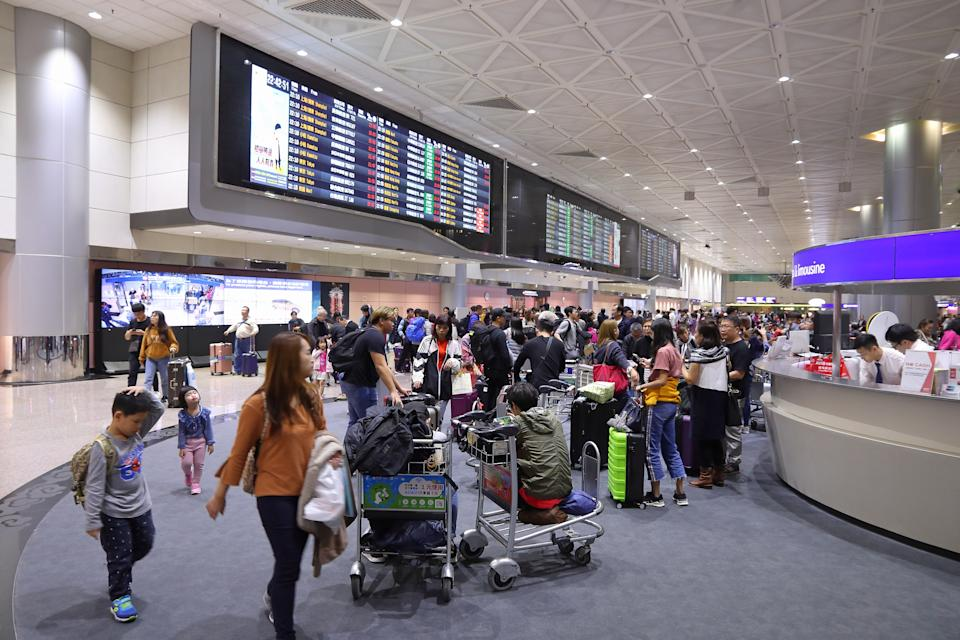People wait at Taoyuan International Airport near Taipei, Taiwan. It is Taiwan's largest and busiest airport.