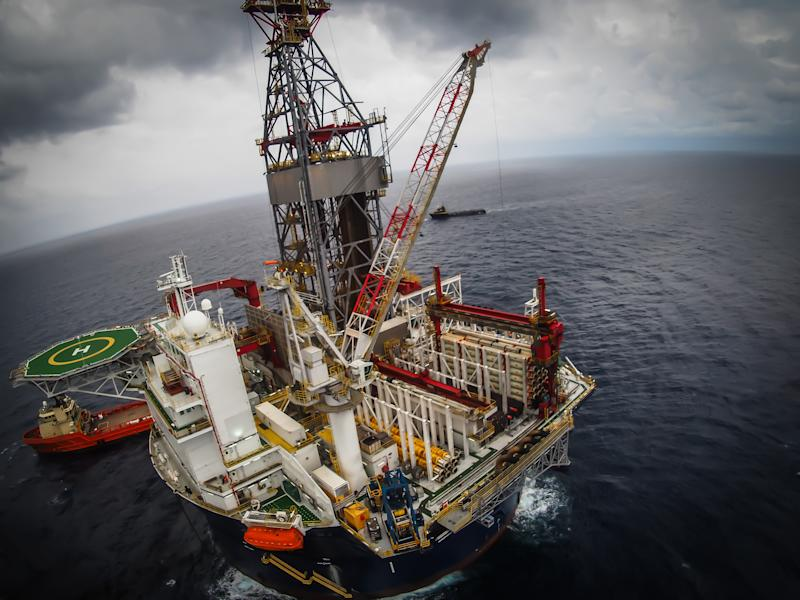An offshore drilling rig at sea.