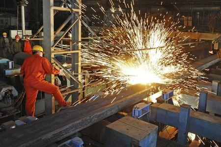 An employee works at a factory of Dongbei Special Steel Group Co., Ltd., in Dalian