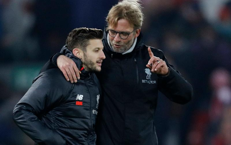 Adam Lallana and Jürgen Klopp -Liverpool midfielder Adam Lallana: Players must sacrifice themselves for team - Credit: Reuters