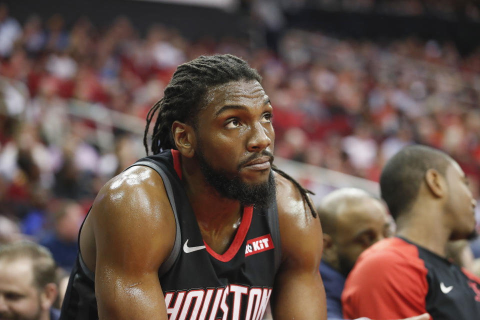 HOUSTON, TX - APRIL 05:  Kenneth Faried #35 of the Houston Rockets watches from the bench in the first half against the New York Knicks at Toyota Center on April 5, 2019 in Houston, Texas.  NOTE TO USER: User expressly acknowledges and agrees that, by downloading and or using this photograph, User is consenting to the terms and conditions of the Getty Images License Agreement.  (Photo by Tim Warner/Getty Images)