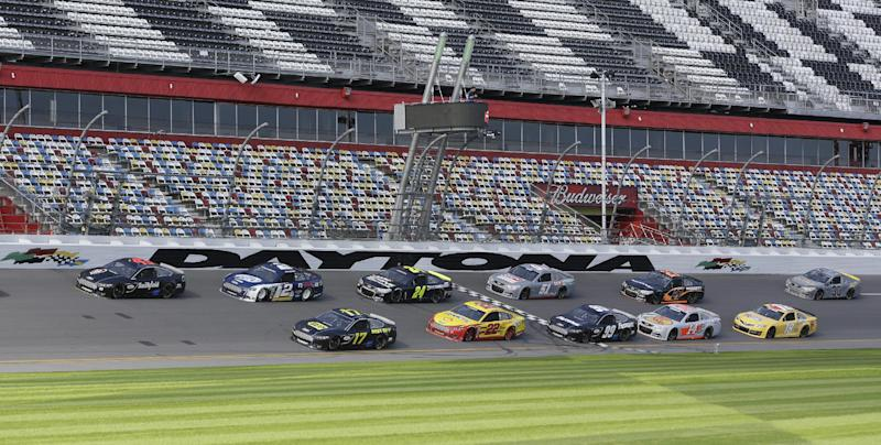 FILE - In this Jan. 11, 2013, file photo, a pack of cars drives past the start/finish line moments before a wreck on the backstretch during NASCAR auto race testing at Daytona International Speedway in Daytona Beach, Fla. There's a buzz about NASCAR and the season-opening Daytona 500 that has nothing to do with an exploding jet dryer or a well-timed tweet. NASCAR's new Gen-6 race car makes its long-awaited debut and the success of the 2013 season could depend heavily on its performance. (AP Photo/John Raoux, File)