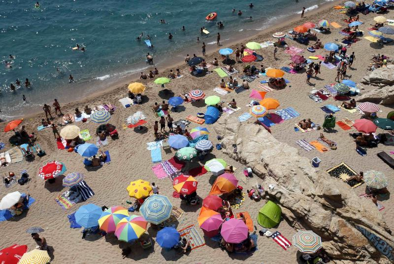 People cool off at the Mediterranean Sea at Calella's beaches, north of Barcelona