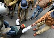 LUCKNOW, INDIA - DECEMBER 18: Pragatisheel Samajwadi Party (Lohiya) workers detained by police after a lathi charge while demonstrating outside the party office to Save Constitution, Save India, at Mall Avenue on December 18, 2019 in Lucknow, India. (Photo by Dheeraj Dhawan/Hindustan Times via Getty Images)