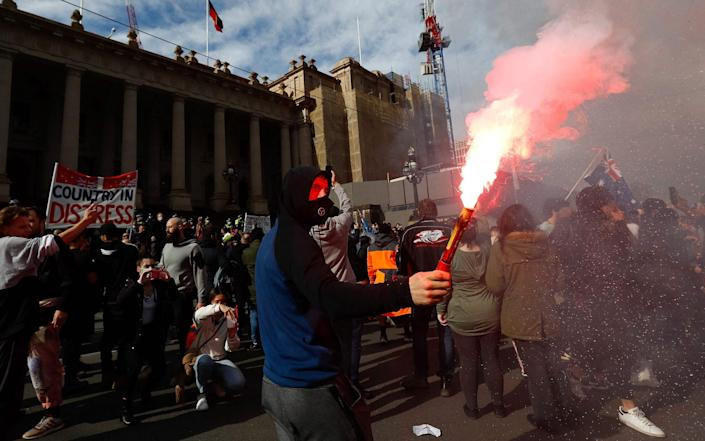 Protesters were also out in Melbourne - CON CHRONIS /AFP