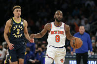 New York Knicks guard Kemba Walker (8) brings the ball up court past Indiana Pacers guard Chris Duarte (3) during the second half of a preseason NBA basketball game Tuesday, Oct. 5, 2021, in New York. The Knicks won 125-104. (AP Photo/Adam Hunger)