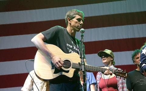 <span>Beto O'Rourke playing alongside his band at&nbsp; Willie Nelson's 45th Fourth Of July Picnic, in Austin</span>