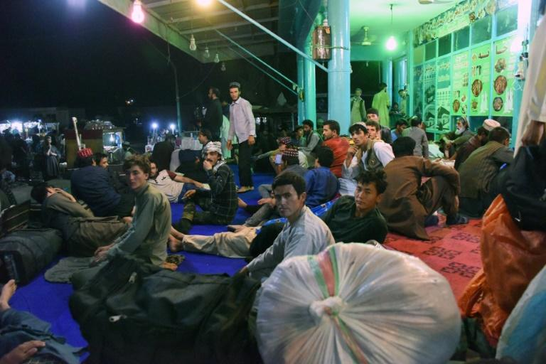Afghan passengers bound for Kabul wait at a bus station in Kandahar province, after the assault on Ghazni severed travel links