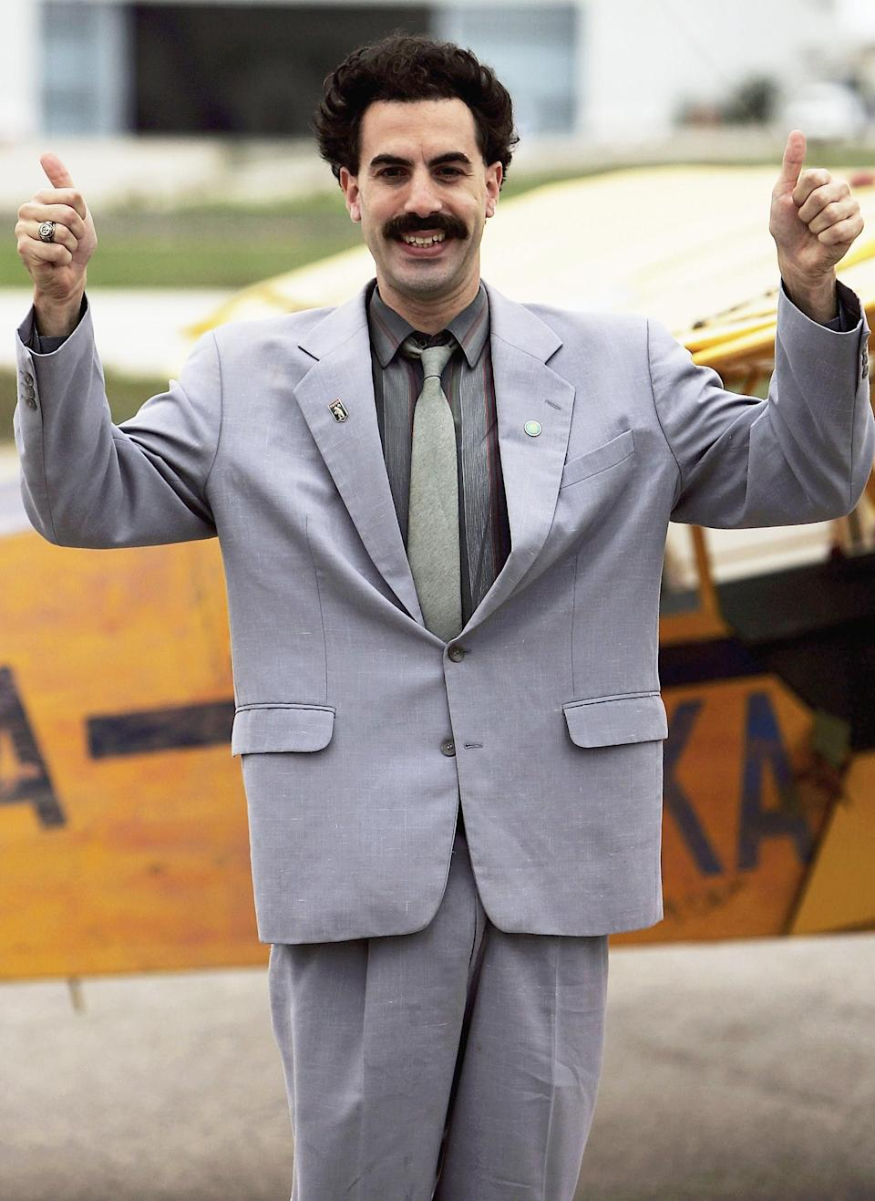 """Sacha Baron Cohen playing the part of his comedy character """"Borat"""" lands at a private airfield on November 2, 2005 in Lisbon, Portugal. 'Borat' arrived in Lisbon as part of a stunt video for tomorrow nights MTV European Music Awards. (Photo: Bruno Vincent/Getty Images)"""