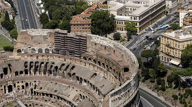 Rome's ancient Colosseum is seen from a helicopter, in this August 12, 2004 file photo. The ancient Colosseum of Rome, where gladiators fought for their lives, is slanting about 40 cm (16 inches) lower on the south side than on the north, and authorities are investigating whether it needs urgent repairs. REUTERS/Alessandro Bianchi/File