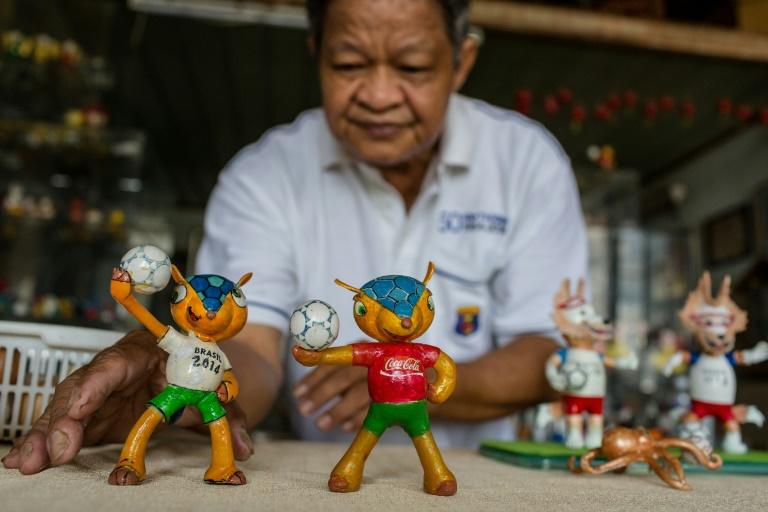 Tam spends hours every day making the models, driven by his football fanaticism
