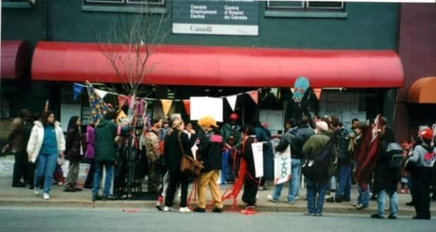 A group of people gather outside the Canada Employment Office on Gottingen Street in Halifax in 1996. The community started occupying the space after the closure of several other businesses in the area. (Lynn Jones/African Canadian and Diaspira Heritage Collection - image credit)