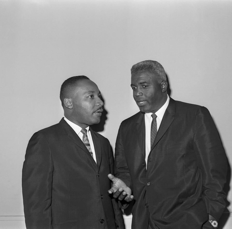 The Rev. Dr. Martin Luther King Jr. (L) and baseball Hall-of-Famer Jackie Robinson chat together before a press conference in New York, September 19th. Dr. King, who arrived to open a drive for funds and a northern
