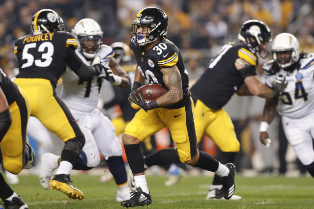 Pittsburgh Steelers running back James Conner (30) runs against the Los Angeles Chargers in the first quarter of an NFL football game, Sunday, Dec. 2, 2018, in Pittsburgh. (AP Photo/Don Wright)