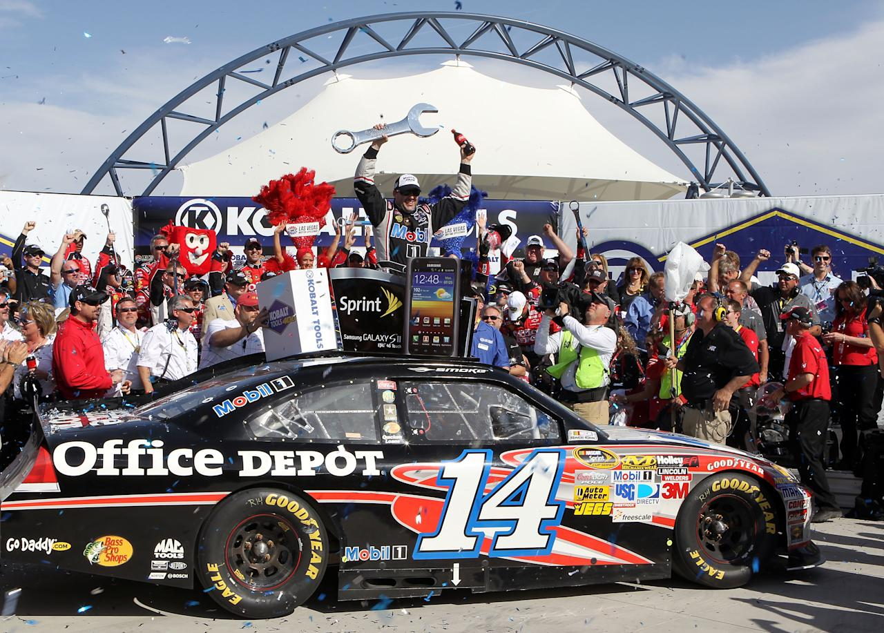 LAS VEGAS, NV - MARCH 11:  Tony Stewart, driver of the #14 Mobil 1/Office Depot Chevrolet, celebrates in Victory Lane after winning the NASCAR Sprint Cup Series Kobalt Tools 400 at Las Vegas Motor Speedway on March 11, 2012 in Las Vegas, Nevada.  (Photo by Jeff Bottari/Getty Images for NASCAR)