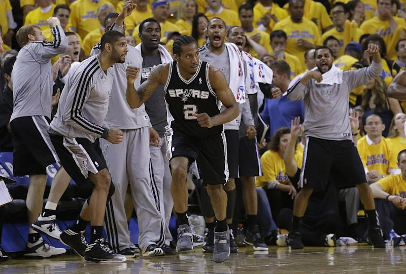 San Antonio Spurs small forward Kawhi Leonard (2) celebrates after making a three-pointer during the fourth quarter of Game 6 of a Western Conference semifinal NBA basketball playoff series against the Golden State Warriors in Oakland, Calif., Thursday, May 16, 2013. The Spurs won 94-82. (AP Photo/Jeff Chiu)