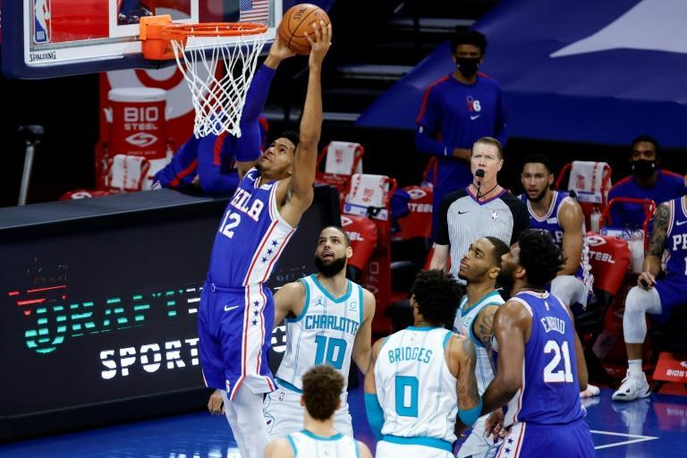Philadelphia's Tobias Harris throws down a dunk in the 76ers' 118-101 NBA victory over the Charlotte Hornets