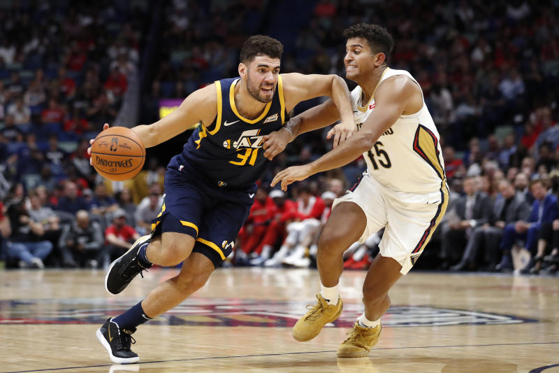 Utah Jazz forward Georges Niang (31) drives past New Orleans Pelicans guard Frank Jackson (15) during the second half of a preseason NBA basketball game in New Orleans, Friday, Oct. 11, 2019. (AP Photo/Tyler Kaufman)