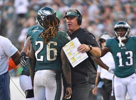 FILE PHOTO: Oct 7, 2018; Philadelphia, PA, USA; Philadelphia Eagles running back Jay Ajayi (26) is consoled by head coach Doug Pederson after fumbling during the third quarter against the Minnesota Vikings at Lincoln Financial Field. Mandatory Credit: Eric Hartline-USA TODAY Sports
