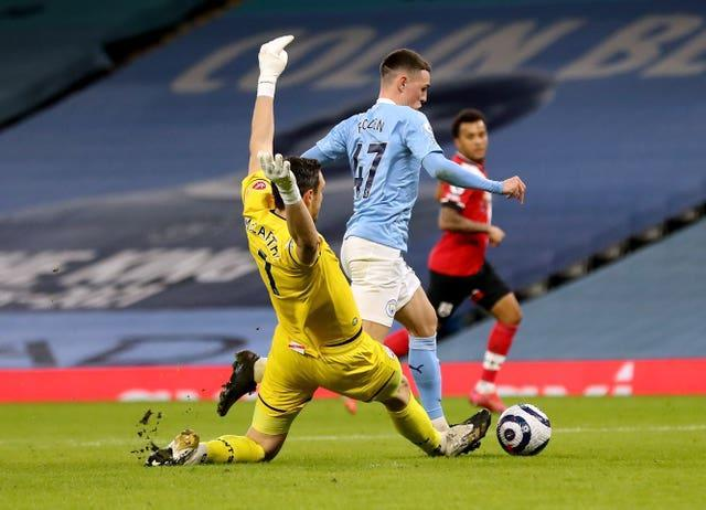 Alex McCarthy tackles Phil Foden