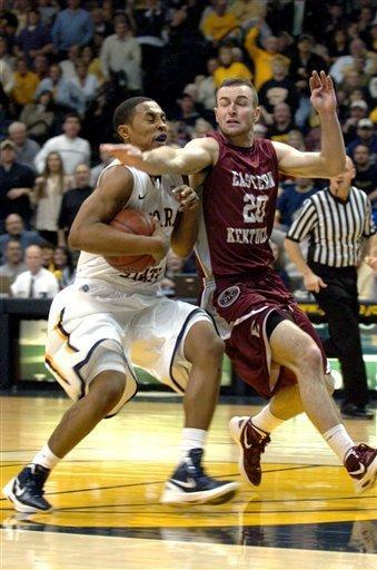 Murray State's Donte Poole (11) is fouled by Eastern Kentucky's Jeff Allgood while driving the lane in the second half of an NCAA college basketball game on Wednesday, Jan. 4, 2012, in Murray, Ky. (AP Photo/Stephen Lance Dennee)