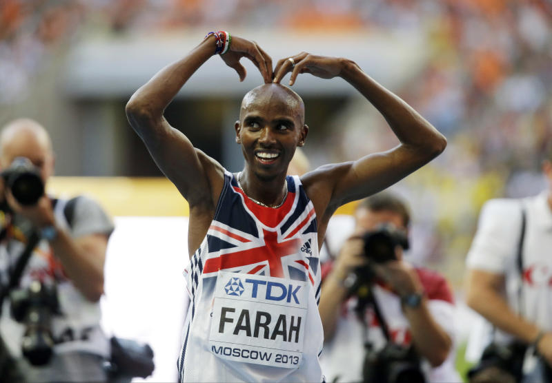 Britain's Mo Farah gestures after winning the men's 10,000-meter final at the World Athletics Championships in the Luzhniki stadium in Moscow, Russia, Saturday, Aug. 10, 2013. (AP Photo/Anja Niedringhaus)