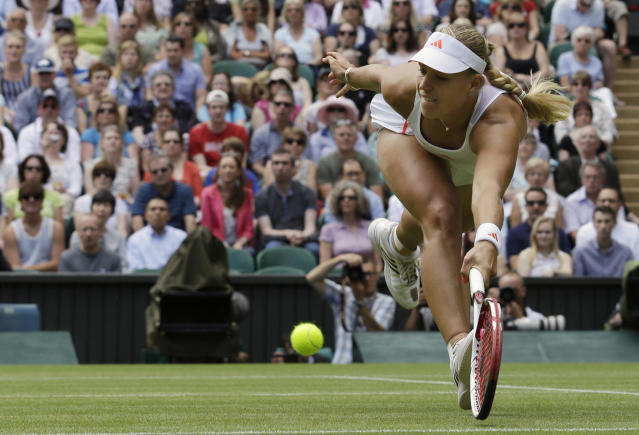 Angelique Kerber of Germany plays a return to Agnieszka Radwanska of Poland during a semifinals match at the All England Lawn Tennis Championships at Wimbledon, England, Thursday, July 5, 2012. (AP Photo/Anja Niedringhaus)