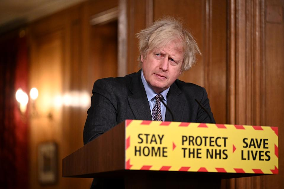 Britain's Prime Minister Boris Johnson attends a virtual press conference inside 10 Downing Street in central London on February 22, 2021, after he earlier set out the Government's roadmap out of the third Covid-19 lockdown. - British Prime Minister Boris Johnson on Monday set out a four-step plan to ease coronavirus restrictions, expressing hope that life could get back to normal by the end of June. In a statement to parliament, he outlined a