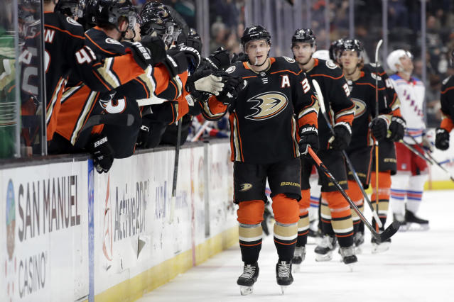 Anaheim Ducks' Jakob Silfverberg, center, celebrates his goal with teammates during the first period of an NHL hockey game against the New York Rangers Saturday, Dec. 14, 2019, in Anaheim, Calif. (AP Photo/Marcio Jose Sanchez)