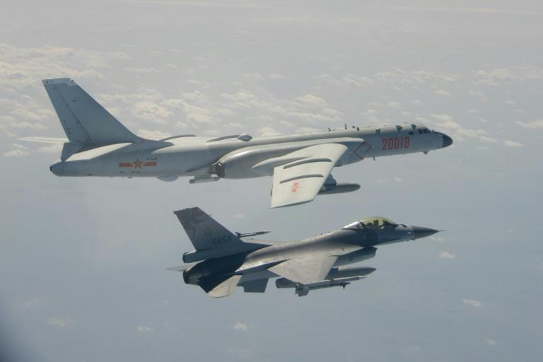 Taiwan's Defence Ministry issued a handout photograph showing one of its F-16 fighter jets flying next to a Chinese H-6 bomber