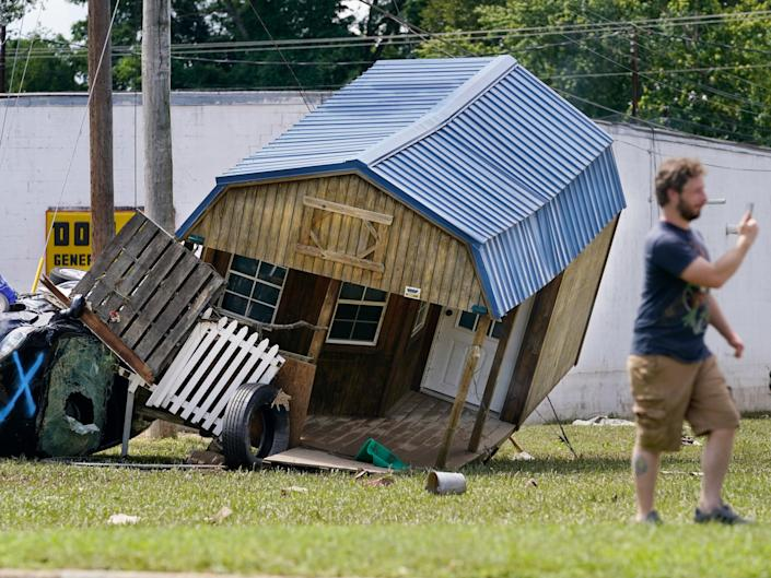 A car and mangled utility building lean against one another in Waverly, Tennesee, after the storm (Mark Humphrey/AP)