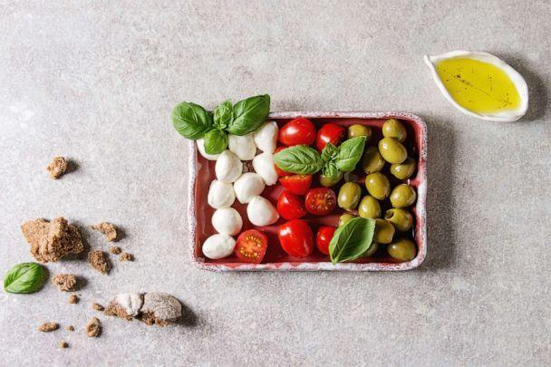 PHOTO: Mozzarella, cherry tomatoes, olives antipasto appetizers. (Universal Images Group via Getty Images)