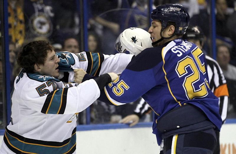 San Jose Sharks' Tommy Wingels, left, and St. Louis Blues' Chris Stewart fight during the second period in Game 5 of an NHL first-round playoff series hockey game on Saturday, April 21, 2012, in St. Louis. (AP Photo/Jeff Roberson)