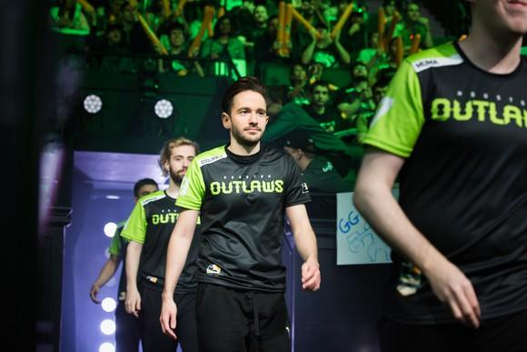 Overwatch League team entering the arena with cheering fans before a match.