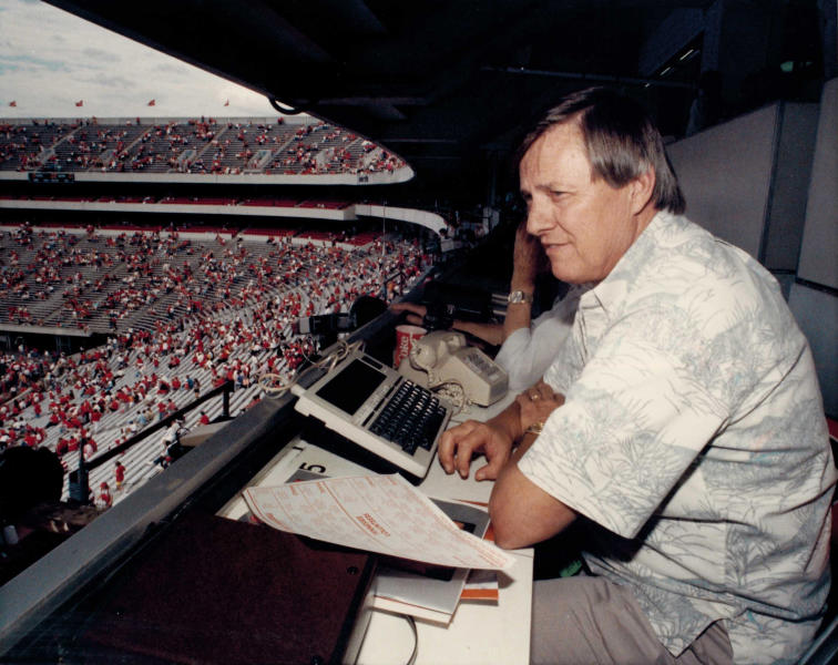 """In this circa 1988 photo, AP sports writer Ed Shearer covers an NCAA college football game between Georgia and Tennessee at Sanford Stadium in Athens, Ga. Shearer, a longtime sports writer with The Associated Press who covered the Olympics, Super Bowl, World Series and Hank Aaron's 715th homer but left his most lasting mark as the """"SEC Seer,"""" a prognosticator of Southern football known throughout the nation, died Monday., June 14, 2019. He was 82. (AP Corporate Archives via AP)"""