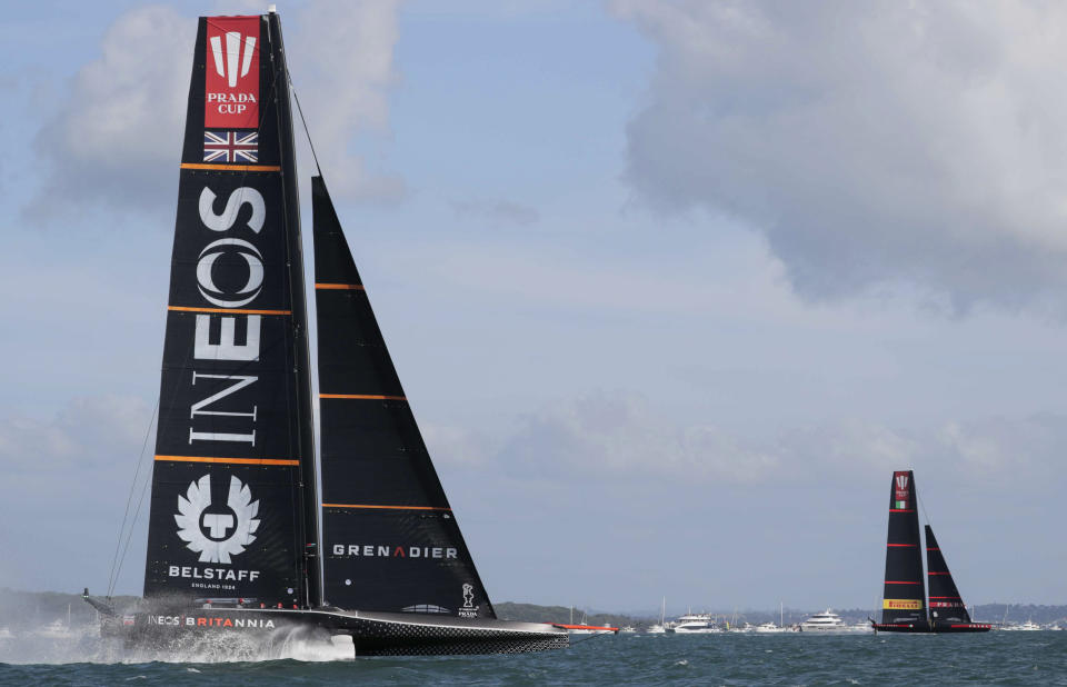 Italy's Luna Rossa, right, leads Britain's INEOS Team UK to win race one of the Prada Cup on Auckland's Waitemata Harbour, New Zealand, Saturday, Feb. 13, 2021. (Michael Craig/NZ Herald via AP)