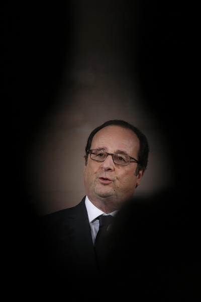 French President Francois Hollande delivers a speech after a visit to the exhibition, ''Mission Ile de la Cite, Le coeur du coeur'' (Mission Ile de la Cite: the heart of the heart) in Paris, Tuesday, Feb. 14, 2017. (Gonzalo Fuentes, Pool via AP)