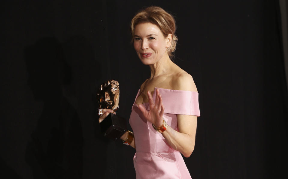 "FILE - Renee Zellweger, winner of Best Actress for Judy, appears backstage at the Bafta Film Awards, in central London on Feb. 2, 2020. Zellweger has earned her first Grammy nomination this year. The ""Judy"" soundtrack, which features Zellweger covering songs like ""Over the Rainbow"" and ""The Trolley Song,"" is nominated for best traditional pop vocal album. (Photo by Joel C Ryan/Invision/AP, File)"