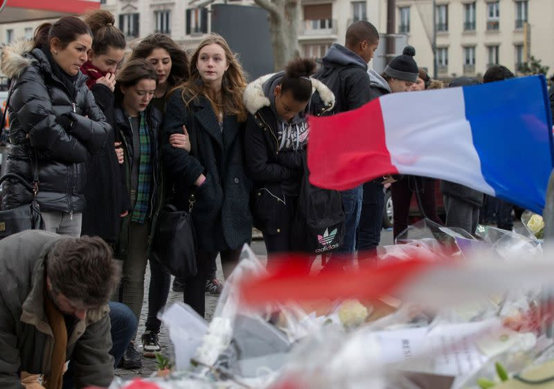 FILE PHOTO: People pay tribute to the victims of a hostage taking at the Hyper Cacher kosher supermarket near Porte de Vincennes in eastern Paris